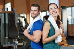 Young happy couple in fitness royalty free stock photography
