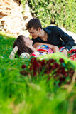 Young happy couple flirting in a summer park Stock Image