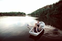 Happy man and woman floating on the boat Royalty Free Stock Image