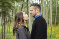 Young happy couple in the forest meadow Royalty Free Stock Image