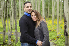 Young happy couple in the forest meadow Stock Images