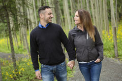 Young happy couple in the forest meadow Royalty Free Stock Photo
