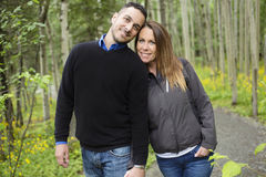 Young happy couple in the forest meadow Stock Photos