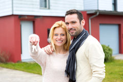 Young happy couple in front of their new house Stock Photo