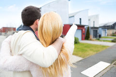 Young happy couple in front of their new house Royalty Free Stock Image