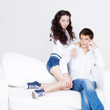 Young happy couple,  guy and girl in a white shirt Stock Photos
