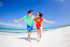Young family of two on white beach have a lot of fun Stock Images