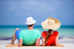 Young family of two on white beach during summer vacation stock photography