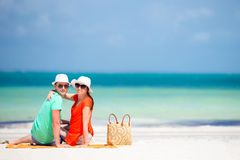 Young family of two on white beach have a lot of fun Royalty Free Stock Photography