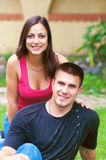 Young happy couple having fun in the garden Stock Photography