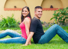 Young happy couple having fun in the garden Stock Images