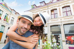 Young happy couple having fun on holidays Stock Images