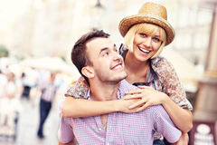 Young happy couple having fun in the Old Town Stock Images