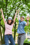 Young happy couple having fun at the park Stock Photos