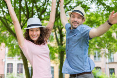 Young happy couple having fun at the park Royalty Free Stock Images
