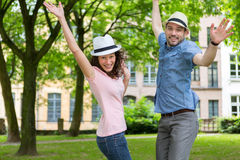 Young happy couple having fun at the park Royalty Free Stock Image