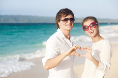 Young happy couple having fun on tropical beach. Royalty Free Stock Photos