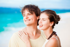 Young happy couple having fun on tropical beach. Royalty Free Stock Photography