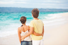 Young happy couple having fun on tropical beach. honeymoon Royalty Free Stock Photo