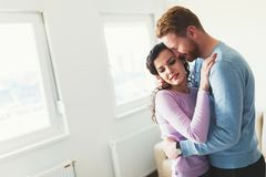 Young happy couple having romantic times at home Stock Photos