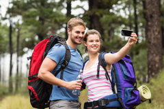 Young happy couple hiking in the nature Royalty Free Stock Image