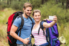 Young happy couple hiking in the nature Royalty Free Stock Photos