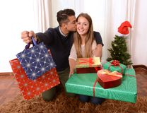 Young Happy Couple holding Christmas Presents Royalty Free Stock Photo