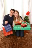 Young Happy Couple holding Christmas Presents Stock Photography