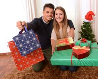 Young Happy Couple holding Christmas Presents Stock Photo