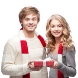 Young happy couple holding chritsmas gift Stock Photo