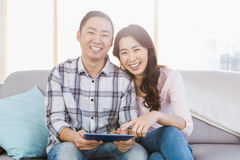 Young happy couple holding digital tablet Stock Photography