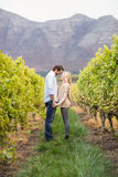 Young happy couple holding hands. In the grape fields Stock Photography