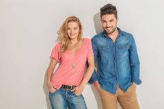 Young happy couple holding hands in pockets. Stock Images