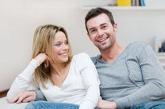 Young happy couple at home. Young happy couple smiling with joy at camera in their home Stock Photos