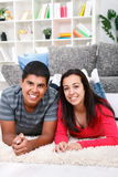 Young happy couple at home. Young happy couple smiling with joy at camera in their home Stock Images