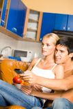 Young happy couple at home Stock Image