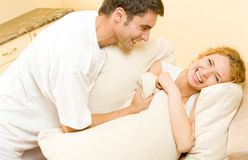 Young happy couple at home Stock Images