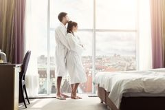 Young happy couple in hotel room in the morning stock photo