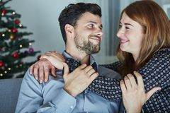 Young happy couple hug on sofa Stock Photography