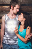 Young happy couple. Hugging against a brick wall Royalty Free Stock Photography