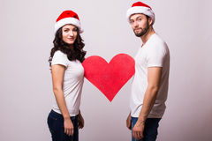 Young Happy Couple hugging and big red heart Royalty Free Stock Images