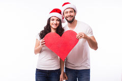Young Happy Couple hugging and big red heart Royalty Free Stock Photography