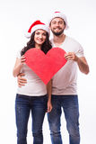 Young Happy Couple hugging and big red heart Royalty Free Stock Photos
