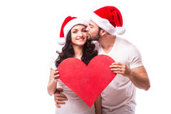 Young Happy Couple hugging and big red heart Stock Image