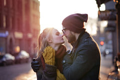 Young happy couple. Hugging on the city street Stock Photos