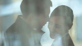 Young happy couple hugging on the city street. Smiling couple in love outdoors stock footage