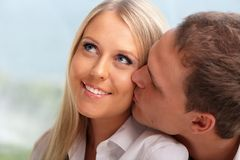 Young happy couple hugging at home Stock Image