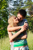 Young happy couple hugging on the outdoors Royalty Free Stock Photos