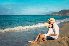 Young happy couple hugging on tropical beach Stock Photo