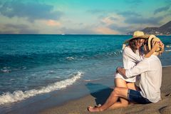 Young happy couple hugging on tropical beach Royalty Free Stock Image